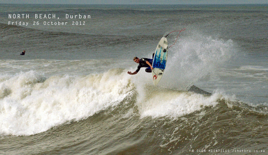 The Durban beachfront during an east swell is a veritable wavepark of lefts, rights, bowls, outside peaks and enough lips to poke your stick at. When the wind swung offshore, Chris Frolich opted for the left bowl and hucked a tail-high frontside air in approval. - Image by: Deon Meintjies / shotbru.co.za